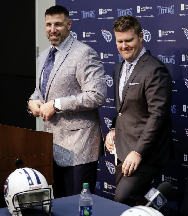 New Tennessee Titans head football coach Mike Vrabel, left, takes the podium after being introduced by general manager Jon Robinson, right, during a news conference Monday, Jan. 22, 2018, in Nashville, Tenn. The Titans hired Vrabel, formerly the Houston Texans defensive coordinator, five days after firing Mike Mularkey. (AP Photo/Mark Humphrey)