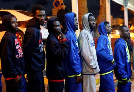 Migrants wait at Mitiga airport before their voluntary return to their countries, east of Tripoli, Libya, December 5, 2017. REUTERS/Ismail Zitouny