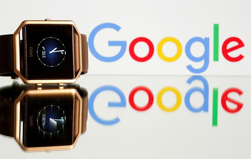 Fitbit Blaze watch is seen in front of a displayed Google logo in this illustration picture taken, November 8, 2019. REUTERS/Dado Ruvic