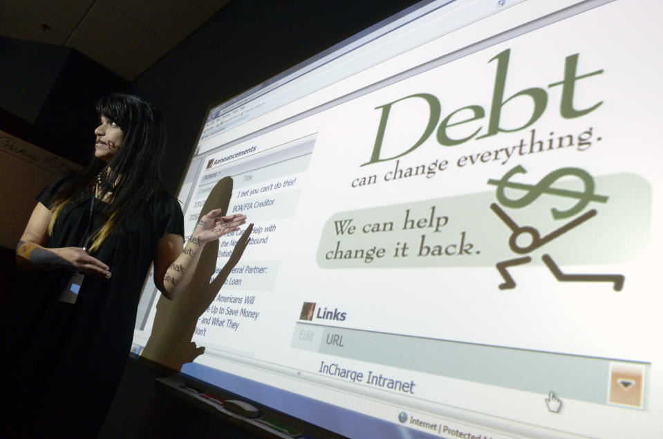 """Dafne Torres, director of operations with InCharge Debt Solutions, talks to counselors during a training session at a call center in Orlando, Florida, August 30, 2011. U.S. President Barack Obama announced his latest stimulus proposal on September 8, that he hopes will give consumers some extra cash to spend. Yet it remains to be seen whether Americans will use the planned lower payroll taxes to buy more goods and services or instead plow the money into paying off their debts. Economists say that trying to find a """"healthy"""" level of debt means little when so much uncertainty about the prospects for the economy are weighing on spending.  Picture taken August 30. To match Feature ECONOMY/DELEVERAGING       REUTERS/Phelan M. Ebenhack  (UNITED STATES - Tags: BUSINESS SOCIETY)"""