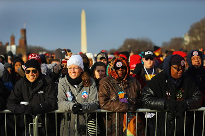 People gather near the U.S. Capitol building on the National Mall for the Inauguration ceremony on January 21, 2013 in Washington, DC. U.S. President Barack Obama will be ceremonially sworn in for his second term today. (Photo by Joe Raedle/Getty Images)