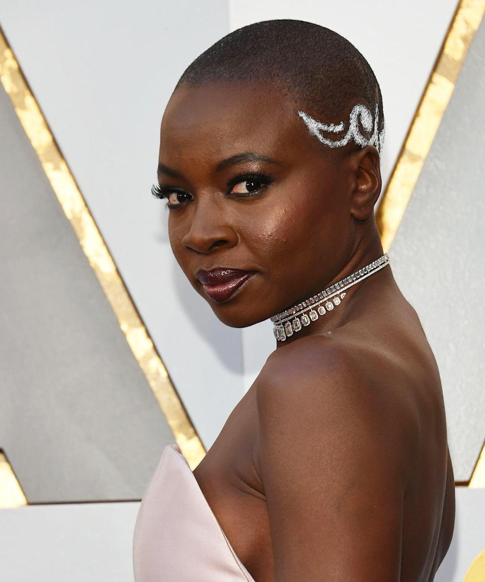 """<p><strong>Danai Gurira, 2018</strong></p><p>Between her roles on <em>The Walking Dead</em> and <em>Black Panther</em>, fans know Danai Gurira as an on-screen badass. The star carried that symbol of strength straight to the Oscars red carpet last year when wearing a <a href=""""https://www.refinery29.com/en-us/2018/03/192518/danai-gurira-oscars-hairstyle-meaning"""" rel=""""nofollow noopener"""" target=""""_blank"""" data-ylk=""""slk:meaningful style"""" class=""""link rapid-noclick-resp"""">meaningful style</a> created by <a href=""""https://www.instagram.com/byvernonscott/"""" rel=""""nofollow noopener"""" target=""""_blank"""" data-ylk=""""slk:Vernon Scott"""" class=""""link rapid-noclick-resp"""">Vernon Scott</a>, who looked to traditional, ancestral tribal African designs as his inspiration.</p><span class=""""copyright"""">Photo: VALERIE MACON/AFP/Getty Images.</span>"""