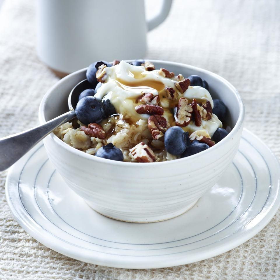 """<p>These overnight oats with Greek yogurt, blueberries and pecans are an easy, on-the-go-breakfast. If desired, reheat the oatmeal before adding the toppings. <a href=""""https://www.eatingwell.com/recipe/251127/creamy-blueberry-pecan-overnight-oatmeal/"""" rel=""""nofollow noopener"""" target=""""_blank"""" data-ylk=""""slk:View Recipe"""" class=""""link rapid-noclick-resp"""">View Recipe</a></p>"""
