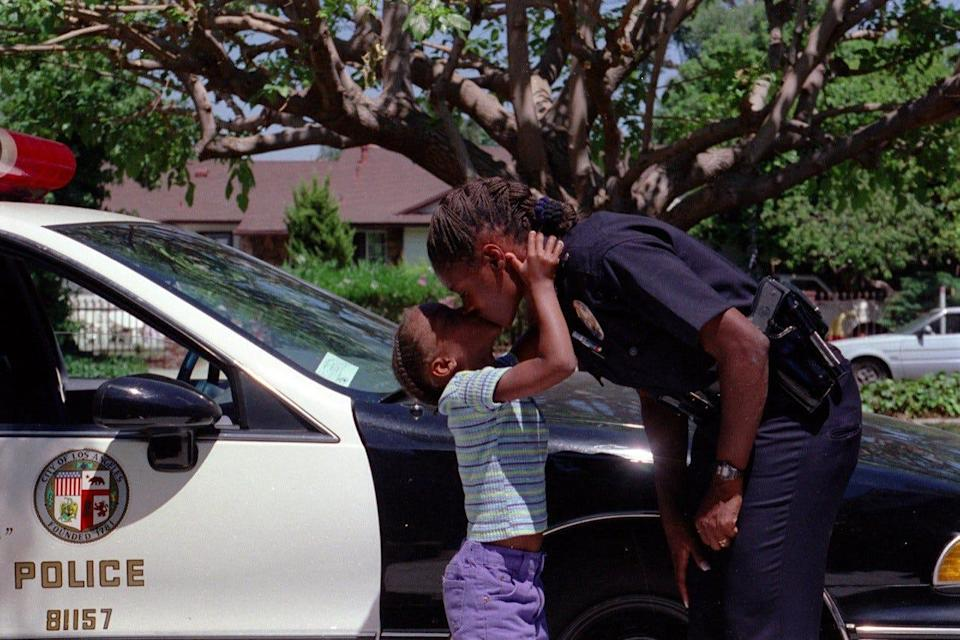 As a kid, reporter Jasmine Vaughn-Hall would often greet her mother, a Los Angeles police officer at the time, in their driveway.