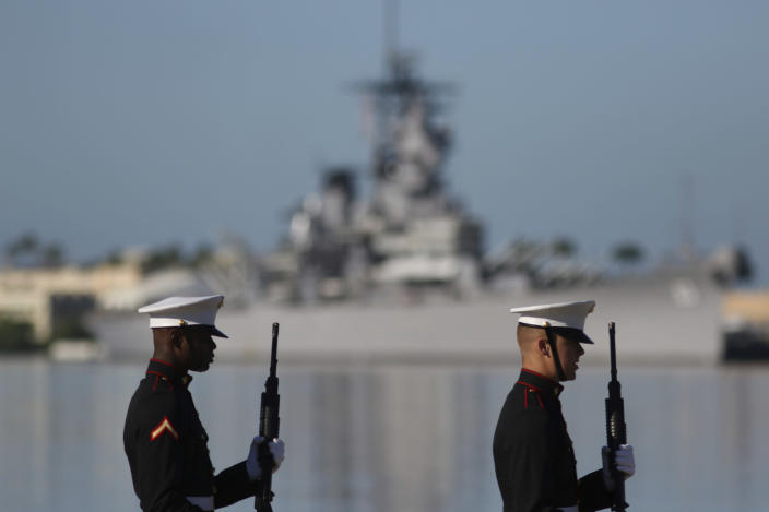 U.S. Marines stand in front of the USS Missouri during a ceremony to mark the 78th anniversary of the Japanese attack on Pearl Harbor, Saturday, Dec. 7, 2019 at Pearl Harbor, Hawaii. Survivors and members of the public gathered in Pearl Harbor to remember those killed when Japanese planes bombed the Hawaii naval base 78 years ago and launched the U.S. into World War II. About a dozen survivors of the attack attended the annual ceremony, the youngest of whom are now in their late 90s. (AP Photo/Caleb Jones)