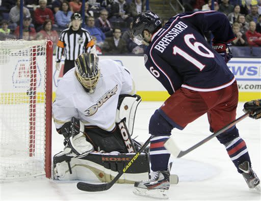 Columbus Blue Jackets' Derick Brassard, right, scores against Anaheim Ducks' Jonas Hiller during the second period of an NHL hockey game Sunday, March 31, 2013, in Columbus, Ohio. (AP Photo/Jay LaPrete)