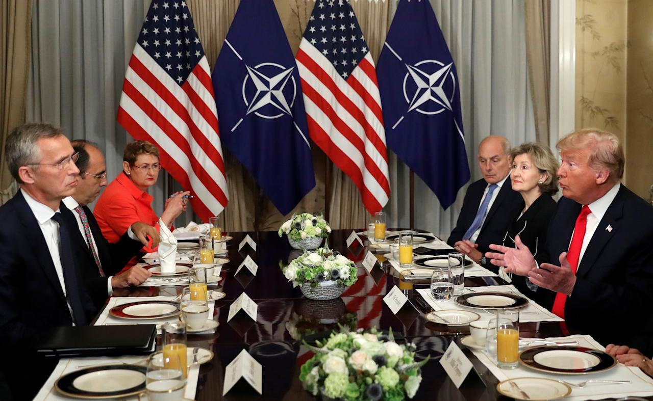 <p>President Trump holds a breakfast meeting with NATO Secretary-General Jens Stoltenberg, left, at the NATO Summit in Brussels on July 11, 2018. (Photo: Kevin Lamarque/Reuters) </p>