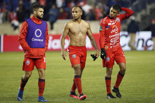 San Carlos midfielder Roberto Cordoba, defender Pablo Arboine and midfieler Randy Chirino, from left, leave the field after the team was eliminated after the second leg of a CONCACAF Champions League soccer match against New York City FC, Wednesday, Feb. 26, 2020, in Harrison, N.J. (AP Photo/Kathy Willens)