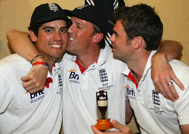 England cricketers Alastair Cook (L), Graeme Swann (C) and James Anderson (R) celebrate in the dressing room with a replica of the Ashes urn, after winning the series 3-1 during day five of the Fifth Ashes Test match between Australia and England, at Sydney Cricket Ground, in Sydney, Australia, on January 7, 2011. AFP PHOTO/TOM SHAW/POOL IMAGE STRICTLY RESTRICTED TO EDITORIAL USE - STRICTLY NO COMMERCIAL USE (Photo credit should read TOM SHAW/AFP/Getty Images)