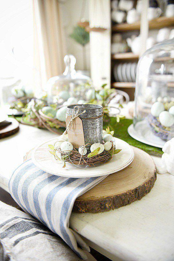 """<p>A DIY tin can, moss, and nest place setting with log chargers screams spring in the best, most rustic ways possible. </p><p><strong>Get the tutorial at <a rel=""""nofollow noopener"""" href=""""https://www.lizmarieblog.com/2016/03/springy-moss-egg-easter-table/"""" target=""""_blank"""" data-ylk=""""slk:Liz Marie Blog"""" class=""""link rapid-noclick-resp"""">Liz Marie Blog</a>.</strong></p><p><strong><a rel=""""nofollow noopener"""" href=""""https://www.amazon.com/Touch-Nature-22040-Grass-4-Inch/dp/B007UZ8WHQ/"""" target=""""_blank"""" data-ylk=""""slk:SHOP NESTS"""" class=""""link rapid-noclick-resp"""">SHOP NESTS</a><br></strong></p>"""