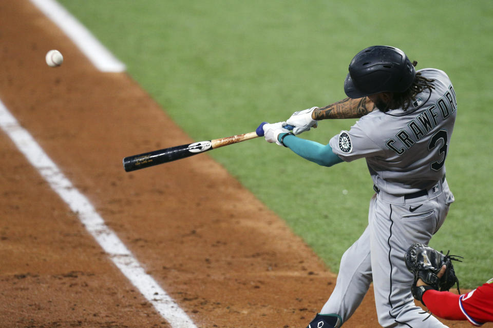 Seattle Mariners J.P. Crawford hits a two-run home run during the fourth inning against the Texas Rangers in a baseball game Friday, May 7, 2021, in Arlington, Texas. (AP Photo/Richard W. Rodriguez)