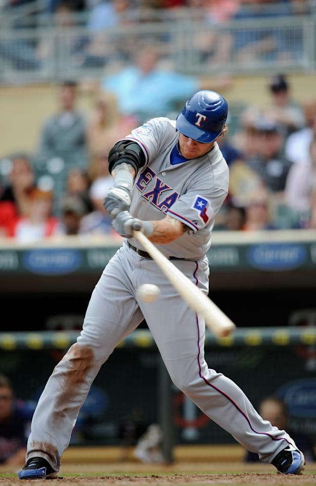 MINNEAPOLIS, MN - APRIL 14: Josh Hamilton #32 of the Texas Rangers hits a double against the Minnesota Twins during the ninth inning on April 14, 2012 at Target Field in Minneapolis, Minnesota. The Rangers defeated the Twins 6-2. (Photo by Hannah Foslien/Getty Images)