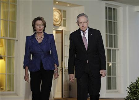 Pelosi and Reid walk from the West Wing of the White House after a meeting with U.S. President Obama in Washington