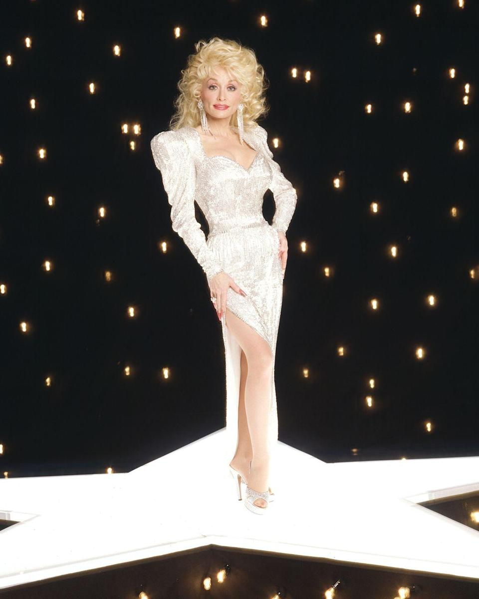 """<p>The over-the-top style trends of the 1980s helped fuel Dolly's eccentric glamour, as she dug deeper into sequins, satin, and shoulder pads. Here, she poses for a photo shoot from her ABC variety show, """"Dolly,"""" which aired from 1987-1988. </p>"""