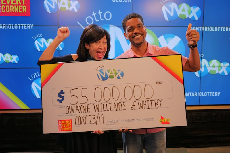 OLG's VP Channel Management, Debora Hume, celebrates a $55 million win with Dwayne Williams from Whitby. OLG