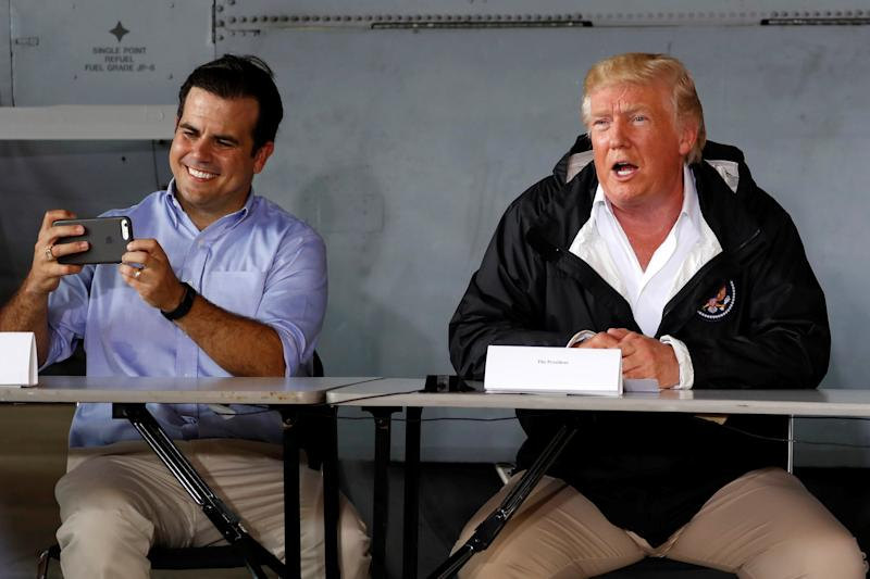 Puerto Rico Gov. Ricardo Rossello, left, takes a picture as he and President Donald Trump receive a briefing on hurricane relief efforts on Oct. 3, 2017. (Jonathan Ernst / Reuters)