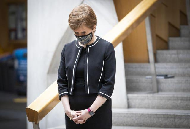 First Minister Nicola Sturgeon observes the minute's silence