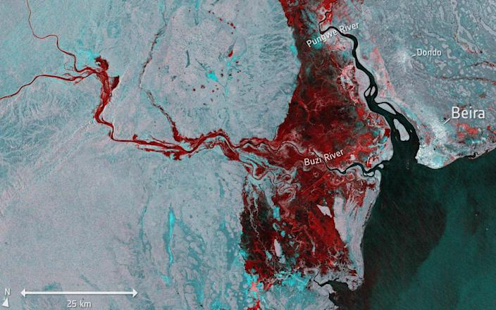 A satellite image from the ESA shows the extent of flooding, depicted in red, around the port town of Beira in Mozambique on March 19, 2019 as tropical cyclone Idai cut a swathe through Mozambique, Zimbabwe and Malawi - AFP