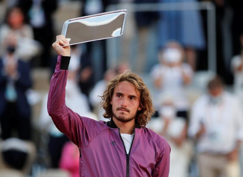 FILE PHOTO: Greece's Stefanos Tsitsipas with the French Open runners-up trophy after losing the final against Serbia's Novak Djokovic