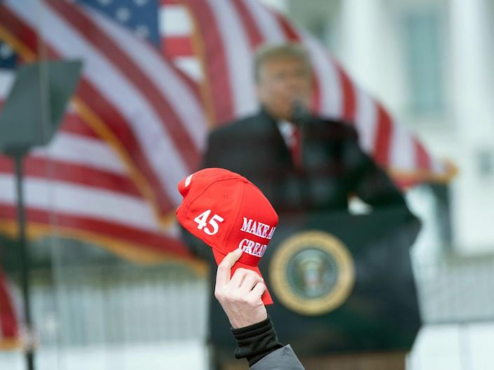 Trump speaks on January 6 with MAGA hat in frame