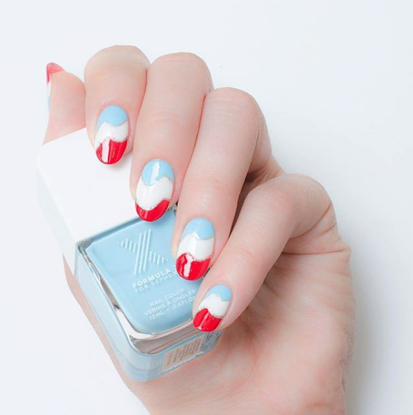 """<p>By switching the original American deep blue to a lighter shade, you accomplish making your mani look sunnier and brighter. Use a thin nail art brush to add a metallic nail polish to divide the colors to take the playfulness up an extra notch. </p><p><a class=""""link rapid-noclick-resp"""" href=""""https://www.amazon.com/OPI-Nail-Lacquer-Its-Boy/dp/B077YJFGWM/?tag=syn-yahoo-20&ascsubtag=%5Bartid%7C10055.g.1278%5Bsrc%7Cyahoo-us"""" rel=""""nofollow noopener"""" target=""""_blank"""" data-ylk=""""slk:SHOP BLUE POLISH"""">SHOP BLUE POLISH</a></p>"""