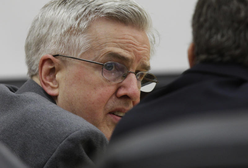 Steve Powell, left, talks with his attorney, Mark Quigley, as they wait for the start of closing arguments in Powell's voyeurism trial, Tuesday, May 15, 2012, in Tacoma, Wash. Powell is the father-in-law of missing Utah mother Susan Powell, who disappeared nearly three years ago in Utah.  (AP Photo/Ted S. Warren)