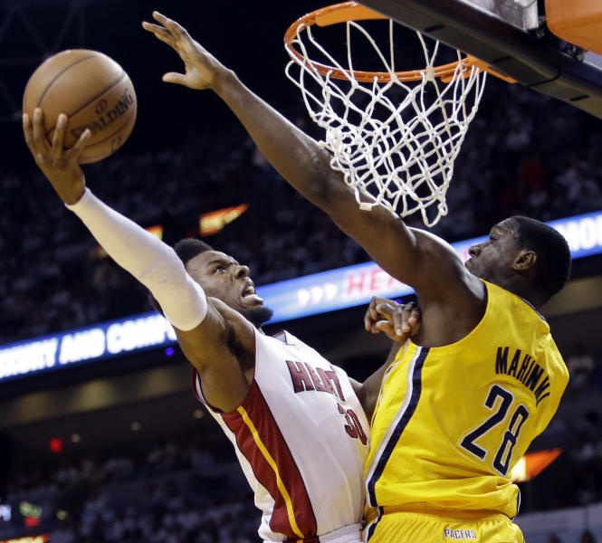 Miami Heat guard Norris Cole (30) attempts to score around Indiana Pacers center Ian Mahinmi (28) during the second half of Game 2 in their NBA basketball Eastern Conference finals playoff series, Friday, May 24, 2013, in Miami. (AP Photo/Lynne Sladky)