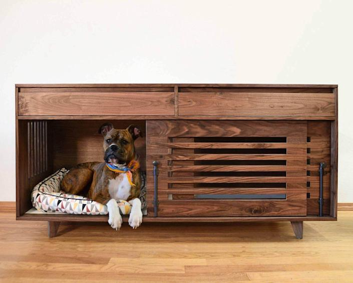 """The design of this credenza is simply unmatched. Not only is the piece made with high-quality, sustainable materials (they're certified by the Forest Stewardship Council)bbut the sliding double doors are easy to use and the two dovetailed drawers are helpful spaces to stash treats, toys, and other pet gear. A soft <a href=""""https://www.architecturaldigest.com/gallery/dog-beds?mbid=synd_yahoo_rss"""" rel=""""nofollow noopener"""" target=""""_blank"""" data-ylk=""""slk:pet bed"""" class=""""link rapid-noclick-resp"""">pet bed</a> will fit easily within. The credenza comes in three different widths, and because they're made to order, you can choose between various hardware styles, drawer accent colors, crate sizes, and whether or not you would like an interior divider (a potential bonus for those who have two pooches). $3250, This is Urban Made. <a href=""""https://thisisurbanmade.com/product/canine-credenza-walnut/"""" rel=""""nofollow noopener"""" target=""""_blank"""" data-ylk=""""slk:Get it now!"""" class=""""link rapid-noclick-resp"""">Get it now!</a>"""