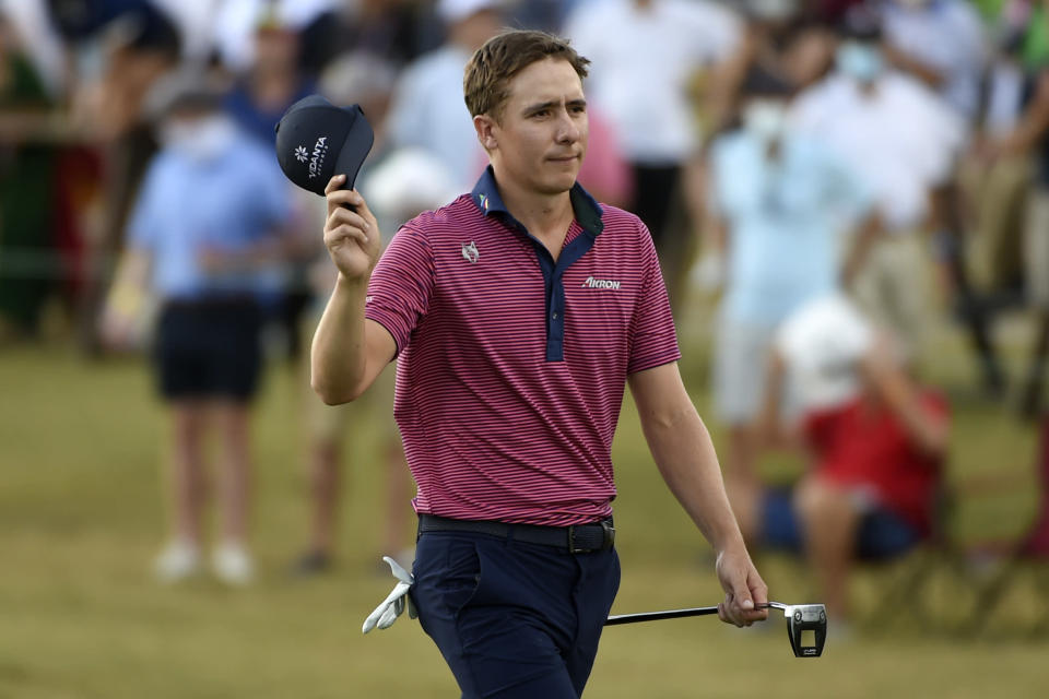 Carlos Ortiz acknowledges the gallery as he walks up the 18th green during the final round of the Houston Open golf tournament, Sunday, Nov. 8, 2020, in Houston. (AP Photo/Eric Christian Smith)