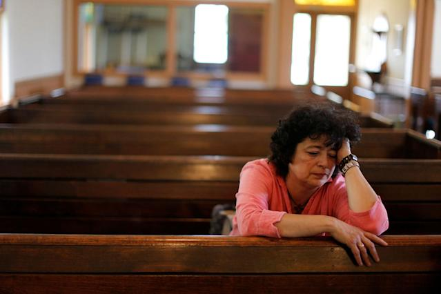 <p>Immigrant Rosa Sabido sits in the United Methodist Church in which she lives while facing deportation in Mancos, Colo., July 19, 2017. (Photo: Lucy Nicholson/Reuters) </p>