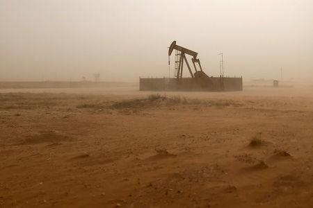 FILE PHOTO: Pump jack lifts oil out of well during sandstorm in Midland