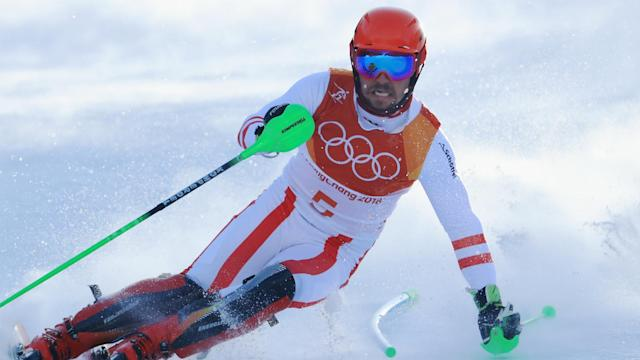 Marcel Hirscher's quest for a third gold medal in Pyeongchang ended quickly after missing a gate and falling in his opening run.
