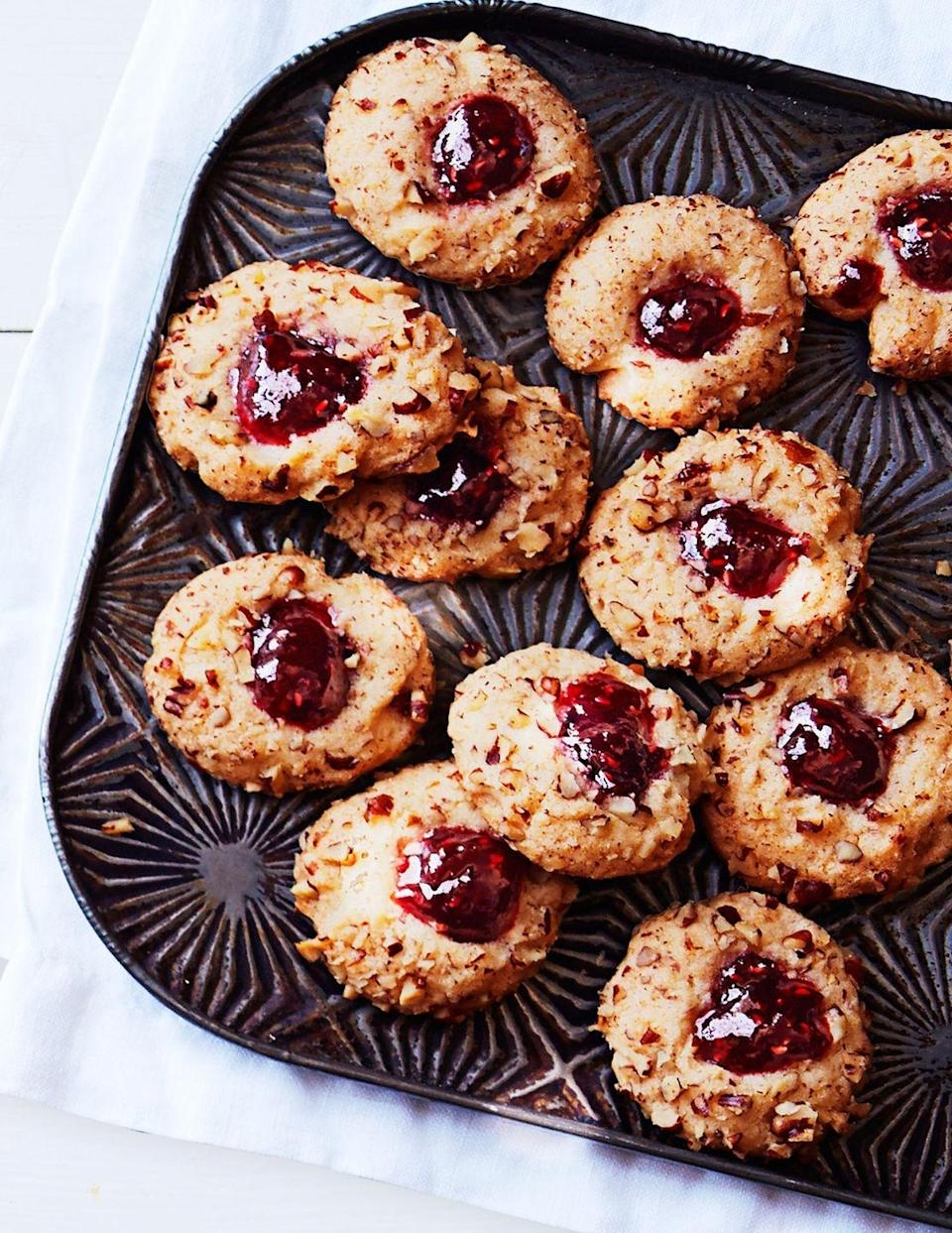 """<p>Simple cookies sprinkled with walnuts and topped with jam are easy way to add festive color your holiday cookie spread.</p><p><em><a href=""""https://www.goodhousekeeping.com/food-recipes/a16189/jammy-thumbprints-recipe-ghk1214/"""" rel=""""nofollow noopener"""" target=""""_blank"""" data-ylk=""""slk:Get the recipe for Jammy Thumbprints »"""" class=""""link rapid-noclick-resp"""">Get the recipe for Jammy Thumbprints »</a></em></p>"""