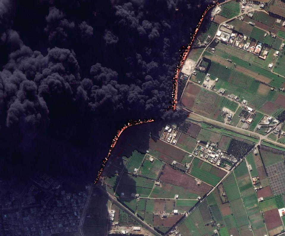 "This Wednesday Feb. 15, 2012 satellite image shows a pipeline fire in Homs, Syria. The pipeline, which runs through the rebel-held neighborhood of Baba Amr, in Homs, had been shelled by regime troops for the previous 12 days, according to two activist groups, the Local Coordination Committees and the Britain-based Syrian Observatory for Human Rights. The state news agency, SANA, blamed ""armed terrorists"" for the pipeline attack last week. It said the pipeline feeds the tankers in the Damascus suburb of Adra, which contribute in supplying gasoline to the capital and southern regions. (AP Photo/DigitalGlobe) MANDATORY CREDIT"