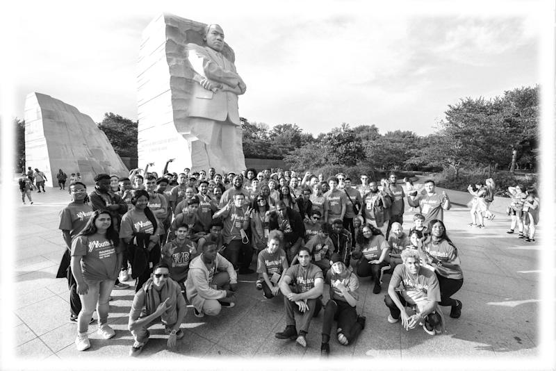 Youth delegates from YouthBuild programs across the US gather in front of the Martin Luther King, Jr. Memorial in Washington DC in June. YouthBuild is a partner of the Serve America Together Campaign. (Photo: courtesy of Denny Henry; digitally enhanced by Yahoo News)