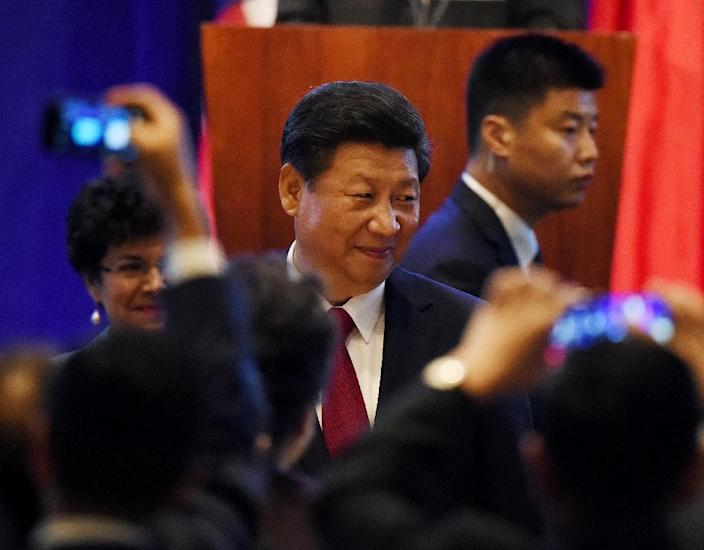 """In a keynote speech on the first day of his state visit to the US Chinese President Xi Jinping stressed a need for more cooperation and understanding of each other's """"strategic intentions"""" (AFP Photo/Mark Ralston)"""