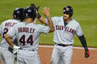 Cleveland Indians' Cesar Hernandez, right, celebrates with Bobby Bradley (44) and Josh Naylor after hitting a grand slam off Pittsburgh Pirates relief pitcher Sam Howard during the seventh inning of a baseball game in Pittsburgh, Friday, June 18, 2021. (AP Photo/Gene J. Puskar)
