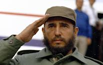 <p>Cuban Prime Minister Fidel Castro is shown saluting in 1971 wearing his customary fatigues and army cap. (AP Photo) </p>