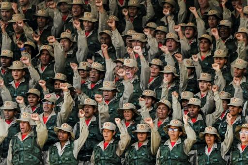 """Members of the Bolivarian militias take part in the launching ceremony of the """"Plan Republica"""", the security operation for the presidential election on May 20, in Caracas"""