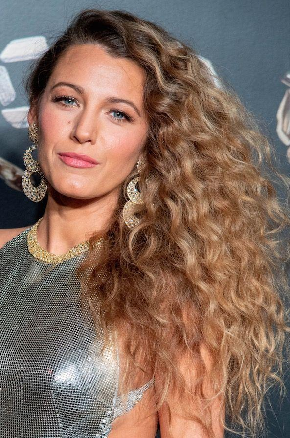 <p>The perm squad just gained a brand new A-list member in the form of Blake Lively. Swapping her usually super smooth hair for a mane of curls, the actress looked like a picture straight out of an 80s yearbook. Because, she's officially ageing backwards. </p>