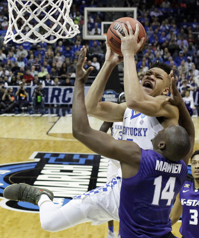 Kentucky forward Kevin Knox (5) shoots against Kansas State forward Makol Mawien (14) during the second half of a regional semifinal NCAA college basketball tournament game, Friday, March 23, 2018, in Atlanta. Kansas State won 61-58. (AP Photo/David Goldman)