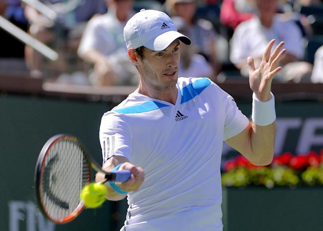 Andy Murray, of Great Britain, returns a hit by Jiri Vesely, of Czech Republic, during a third round match at the BNP Paribas Open tennis tournament, Monday, March 10, 2014, in Indian Wells, Calif. (AP Photo/Mark J. Terrill)