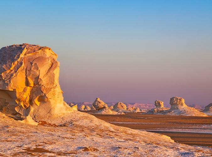 """<p>Sahra al-Beida (called the """"White Desert"""" in English) is a barren stretch of white rock spires and chalk towers. It's located in Farafra, an area inhabited mostly by bedouins.</p>"""