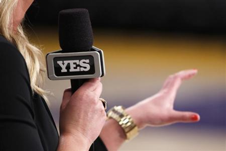 A reporter goes on air for YES Network before the Los Angeles Lakers played the Brooklyn Nets in Los Angeles on Nov. 20, 2012. (REUTERS/Danny Moloshok)