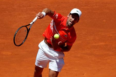 Djokovic in Madrid Open semi-finals after Cilic food poisoning withdrawal
