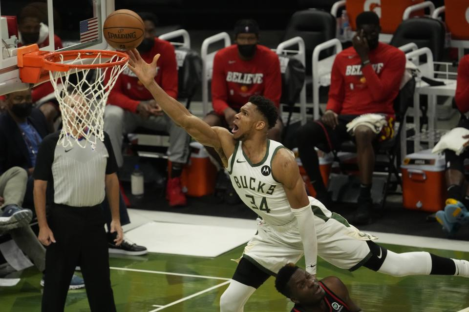 Milwaukee Bucks' Giannis Antetokounmpo shoots over Atlanta Hawks' Clint Capela during the second half of Game 2 of the NBA Eastern Conference basketball finals game Friday, June 25, 2021, in Milwaukee. (AP Photo/Morry Gash)