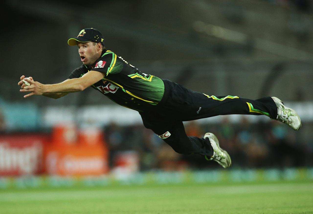 SYDNEY, AUSTRALIA - JANUARY 26:  Ben Laughlin of Australia dives to take a catch and dismiss Tillakaratne Dilshan of Sri Lanka during game one of the Twenty20 international match between Australia and Sri Lanka at ANZ Stadium on January 26, 2013 in Sydney, Australia.  (Photo by Mark Metcalfe/Getty Images)
