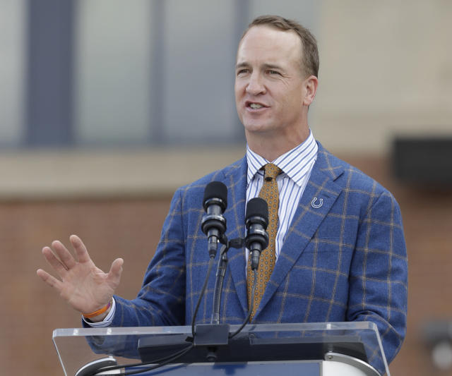 Peyton Manning is reportedly mulling joining the ownership group with the leading bid to buy the Carolina Panthers. (AP)