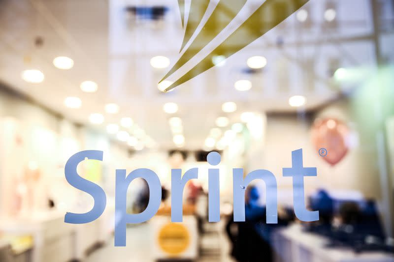 FILE PHOTO: A Sprint sign is seen on top of a Sprint retail store in New York