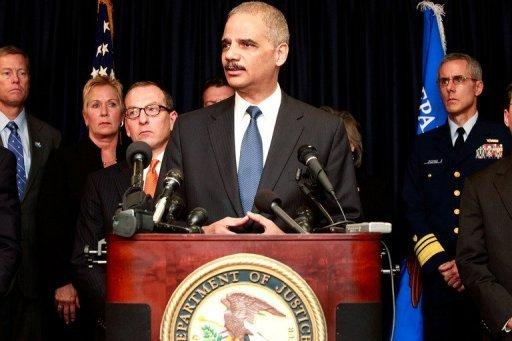 """US Attorney General Eric Holder addresses the media while announcing new criminal charges in the case against the BP oil company. Holder noted that the Justice Department had """"failed to resolve"""" a civil case to determine how much BP should pay in environmental fines"""